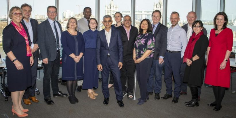group of people standing with Sadiq Khan